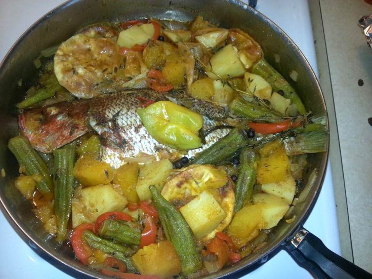 Steamed Fish With vegetables - Fish Being Cooked in FryingPan