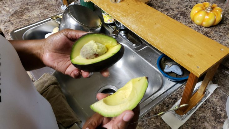 Mom cutting avocado (pear)