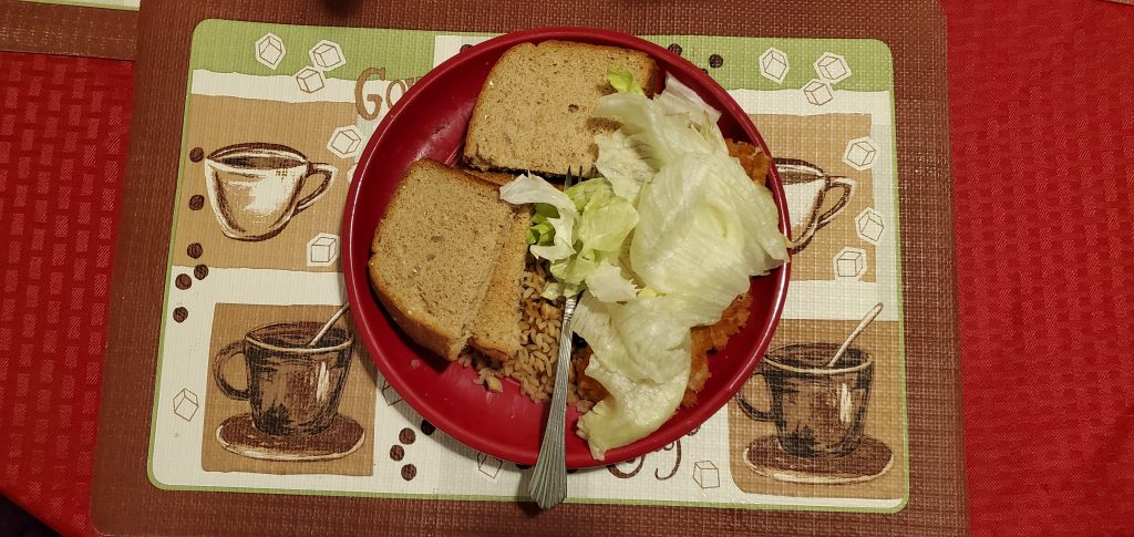 Gungo Rice and Peas with butter bean and baked chicken plus bread and lettuce